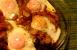 Huevos en purgatorio con alcachofas y patatas